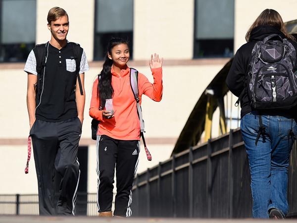 Natalie walking the bridge to success